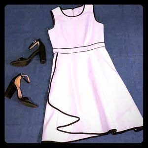 White Calvin Klein cocktail dress with black trim